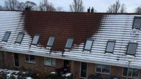 Ein Teil dieses Hausdaches bleibt schneefrei: Die Polizei macht eine erstaunliche Entdeckung