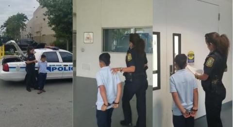 7-Jähriger wird in Handfesseln abgeführt, nachdem er seine Lehrerin angreift